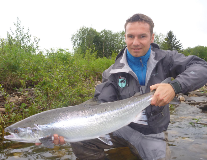 Daniel with a fresh and sea-liced salmon about 7kg.